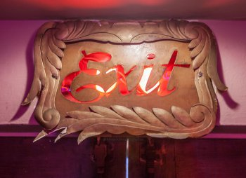 Skouras-style EXIT sign