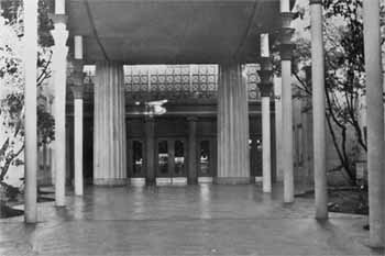 Forecourt and main entrance doors with the 1940 canopy, designed by S. Charles Lee, overhead (JPG)