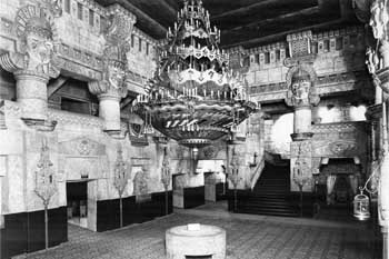 1929 view of the lobby courtesy <i>San Antonio Express-News</i>. Note the sacrificial altar under the chandelier (sold in the 1960s) and the curious bird and birdcage hanging from the wall on the extreme right of the photo (JPG)